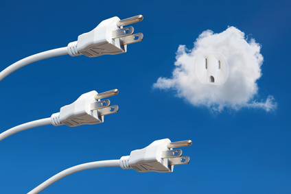 Power cords in the sky with an electrical outlet set in a cloud